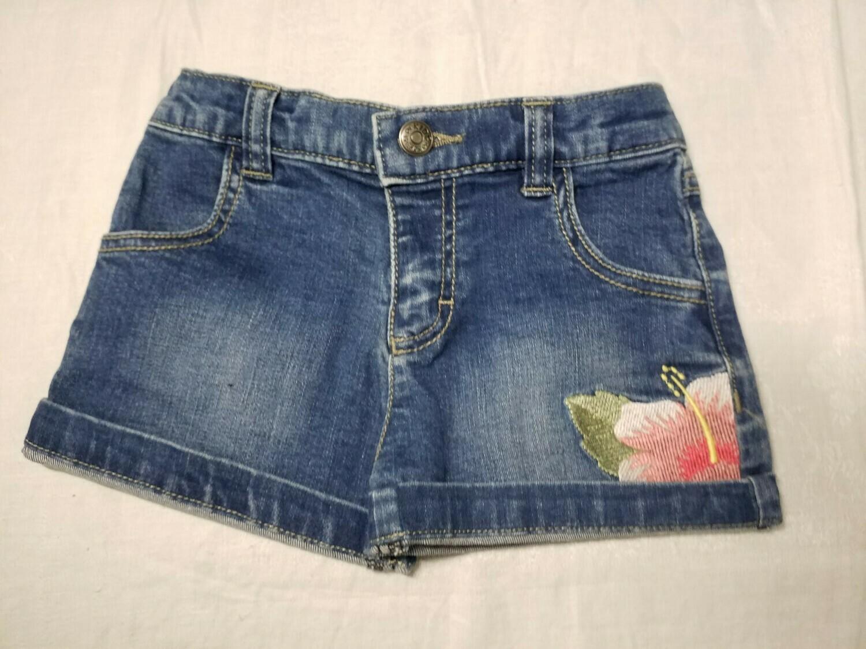 Short jeans imprimé fleur tropicale