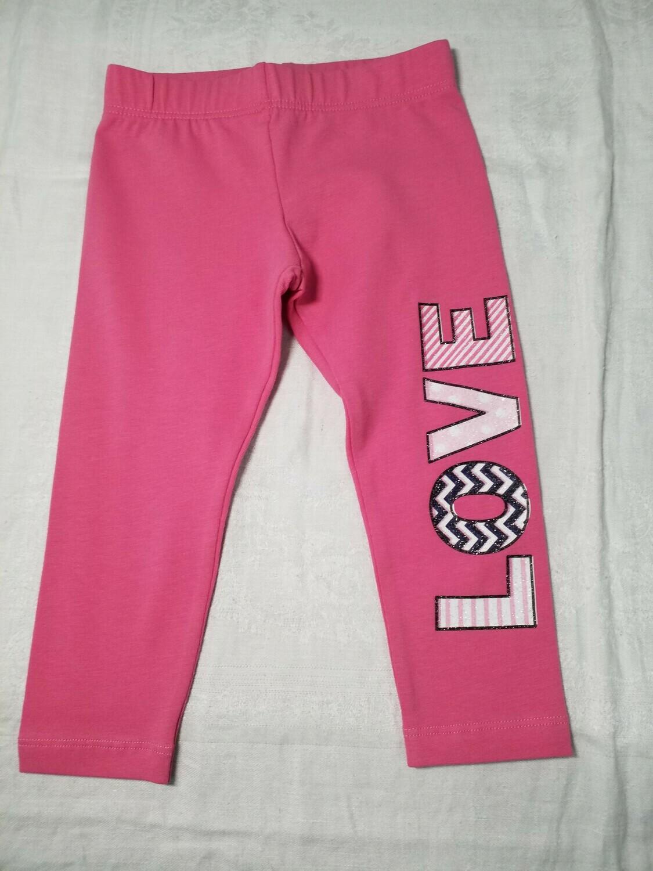 Legging corsaire rose imprimé LOVE