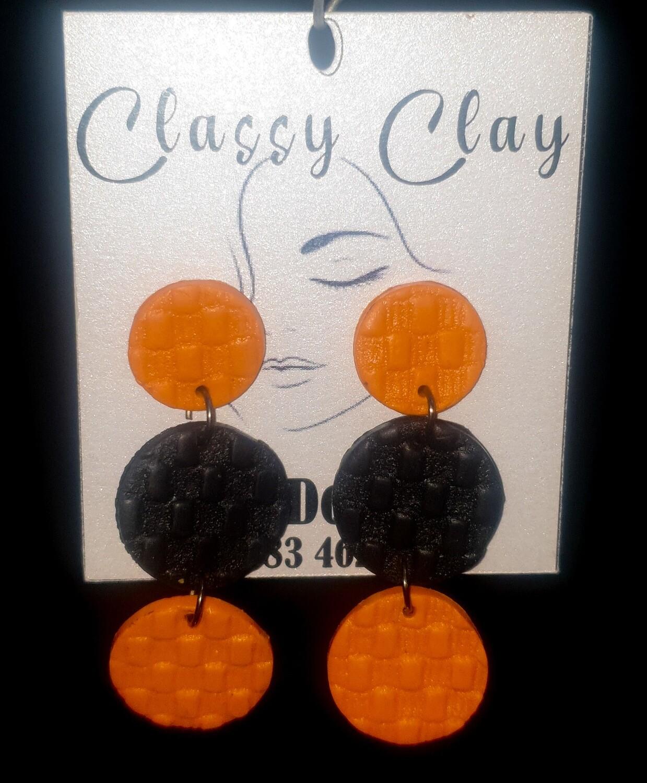 Orange and black hanging circles earrings