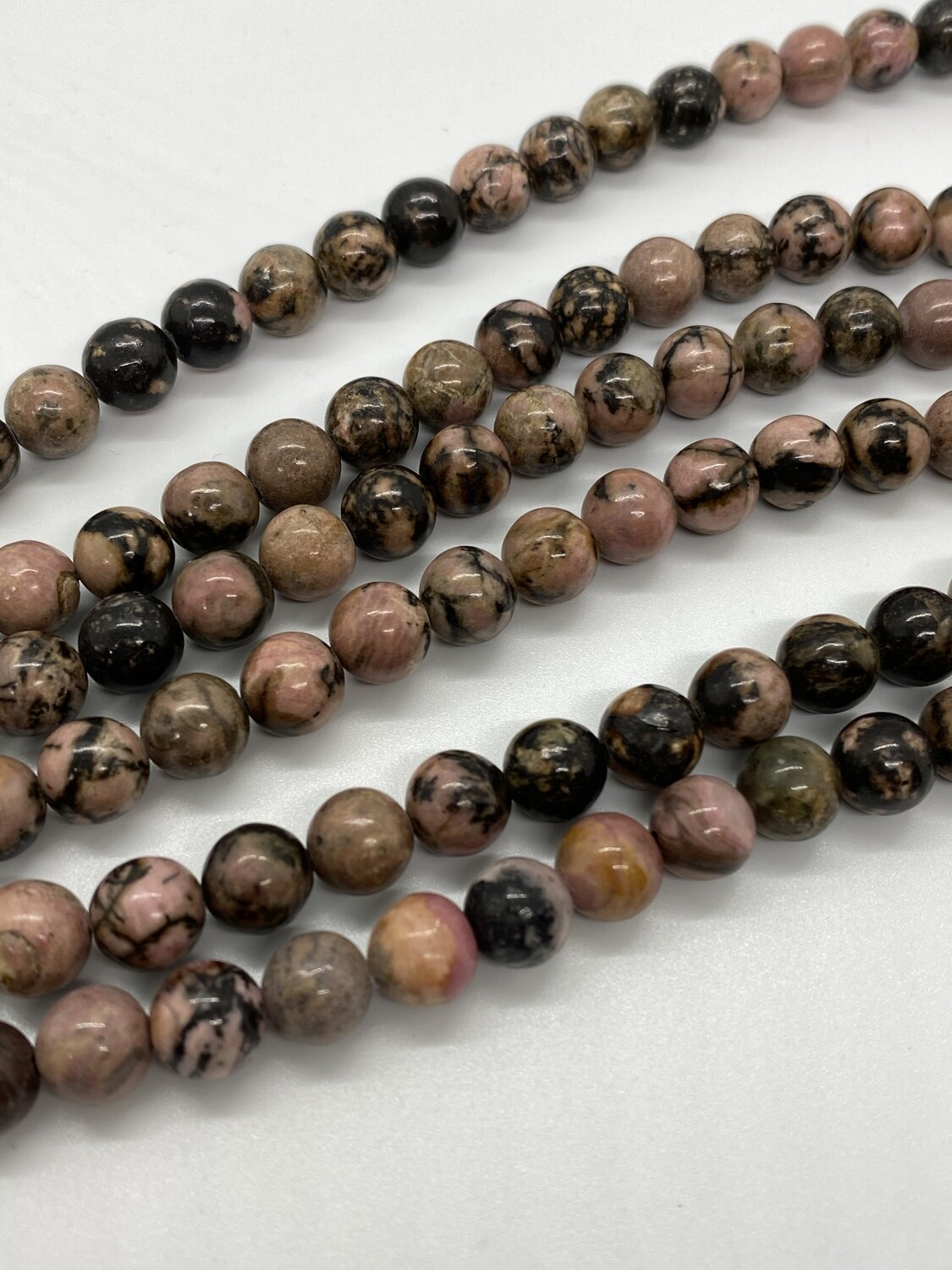 8016 Rhodonite w/matrix round 8mm.