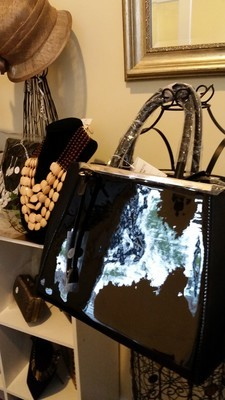 Black Patent Leather Bag with Gold Accents