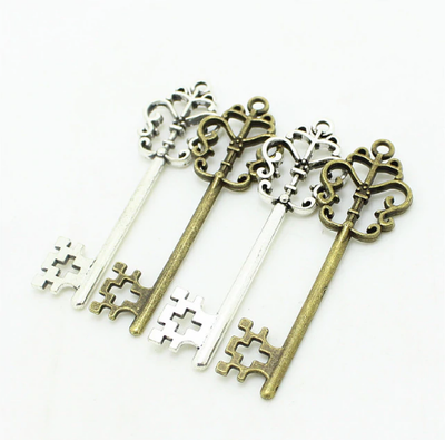 Llaves Decorativas Veal Grandes - Set de 50) COLOR: Plata y Bronce