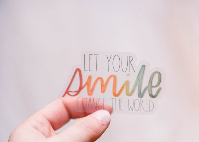 Let Your smile change the world Sticker
