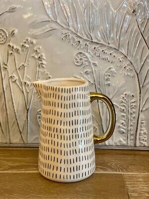 Gold and White Ceramic Pitcher with Black Details