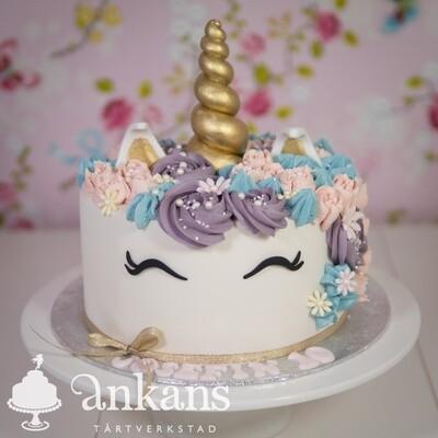 Unicorntårta med horn, man och rosett
