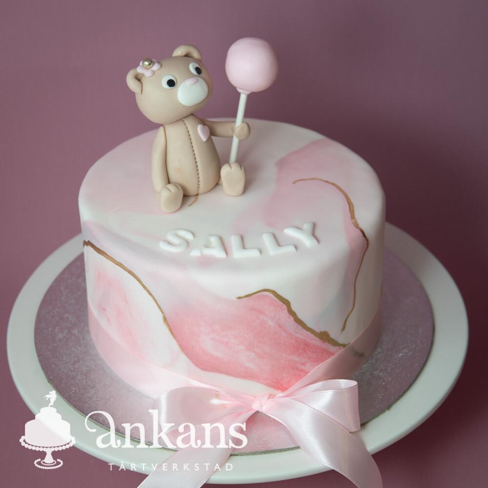 Marmorerad tårta med nalle som håller ballong