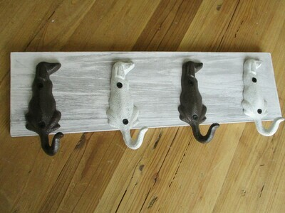 4 DOG TAIL HOOKS ON DISTRESSED WOOD
