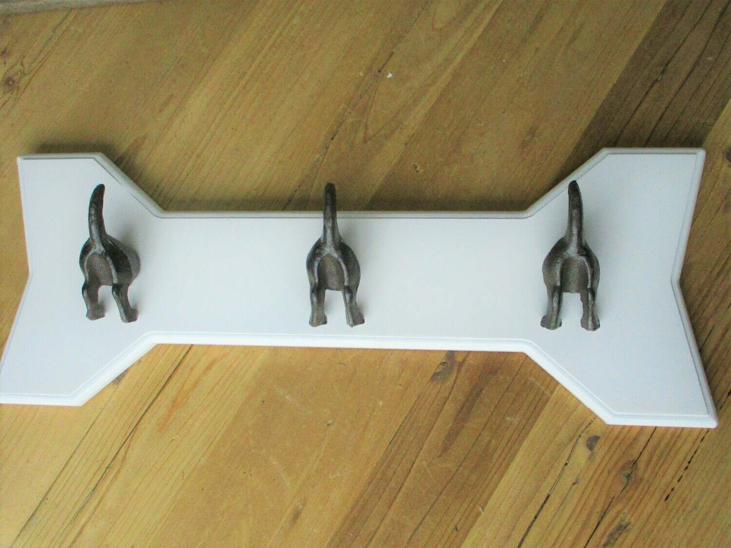 3 DOG TAIL COAT HOOKS ON WHITE BACKING