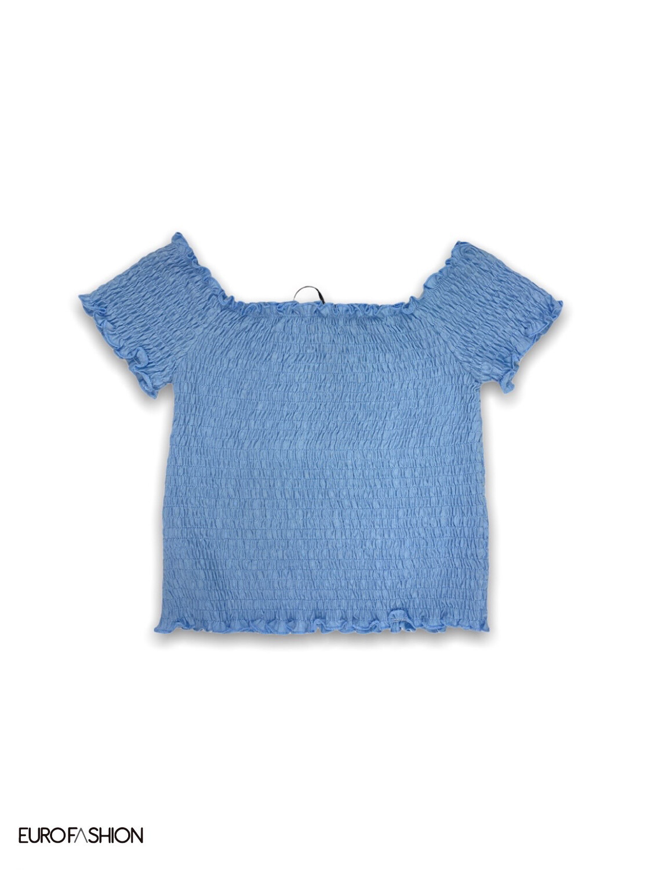 Camiseta hombro descubierto goma