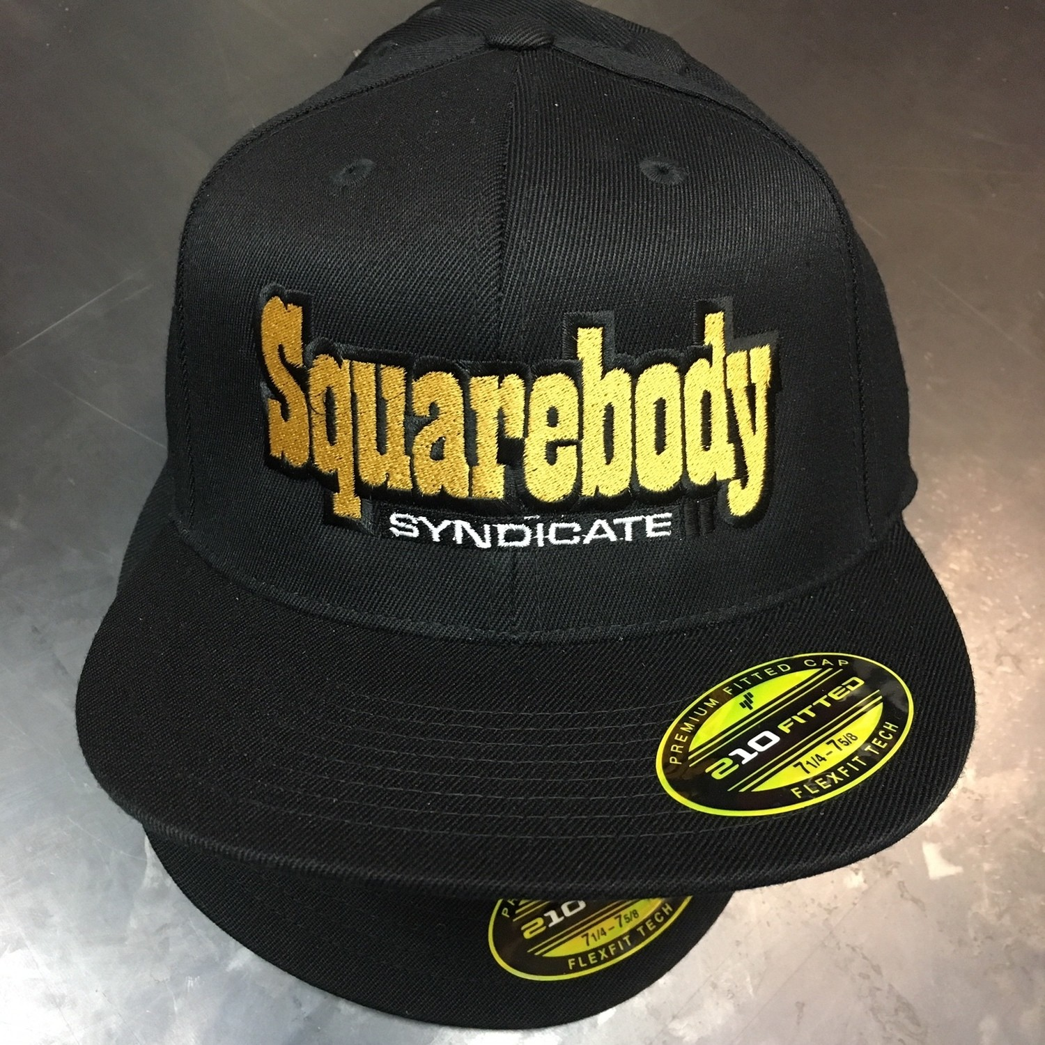 THE OG FLEXFIT 210 SBS SYNDICATE 2 LOGO BLACK HAT