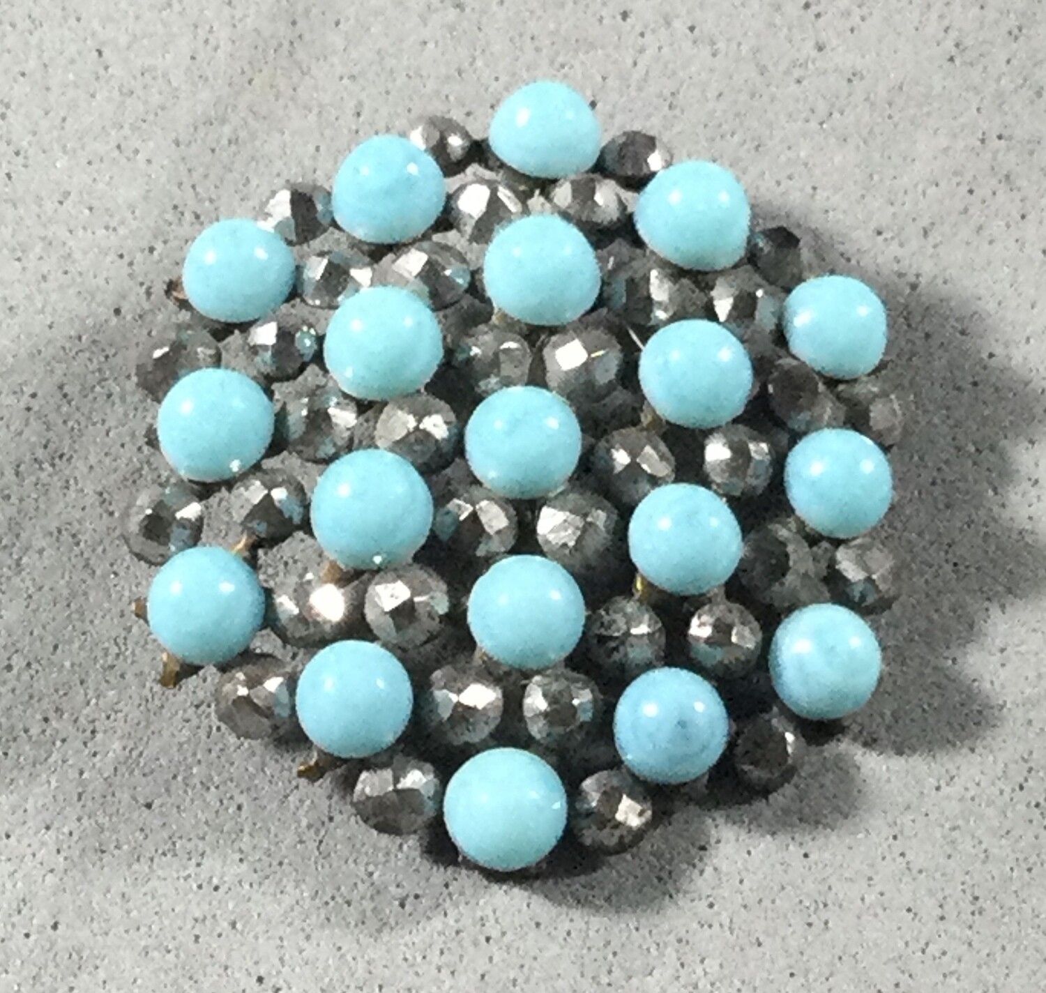 Turquoise Glass and Faceted Steel