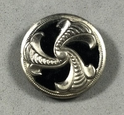 Velvet background triad in silvered metal