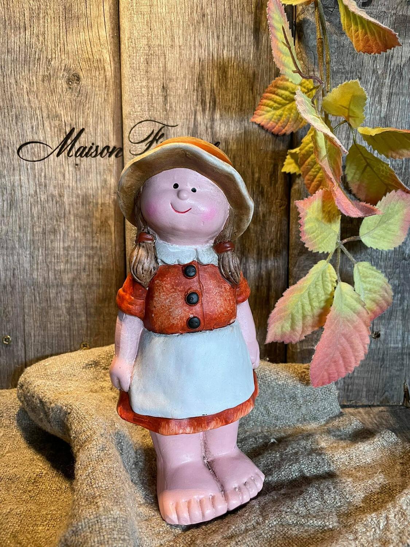 Herfst meisje met oranje kleedje 22cm