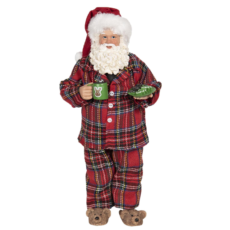 Kerstman in pyjama