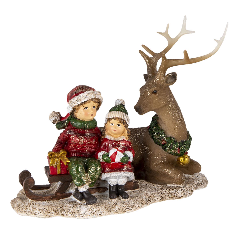 Kerst kindjes bij rendier