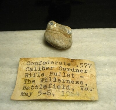 JUST ADDED ON 5/20 - THE BATTLE OF THE WILDERNESS - Fired Confederate Gardner Bullet - Partially Mushroomed - May Have Wood Attached -  with Original Collection Label