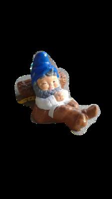 Gnome Laying on Stump