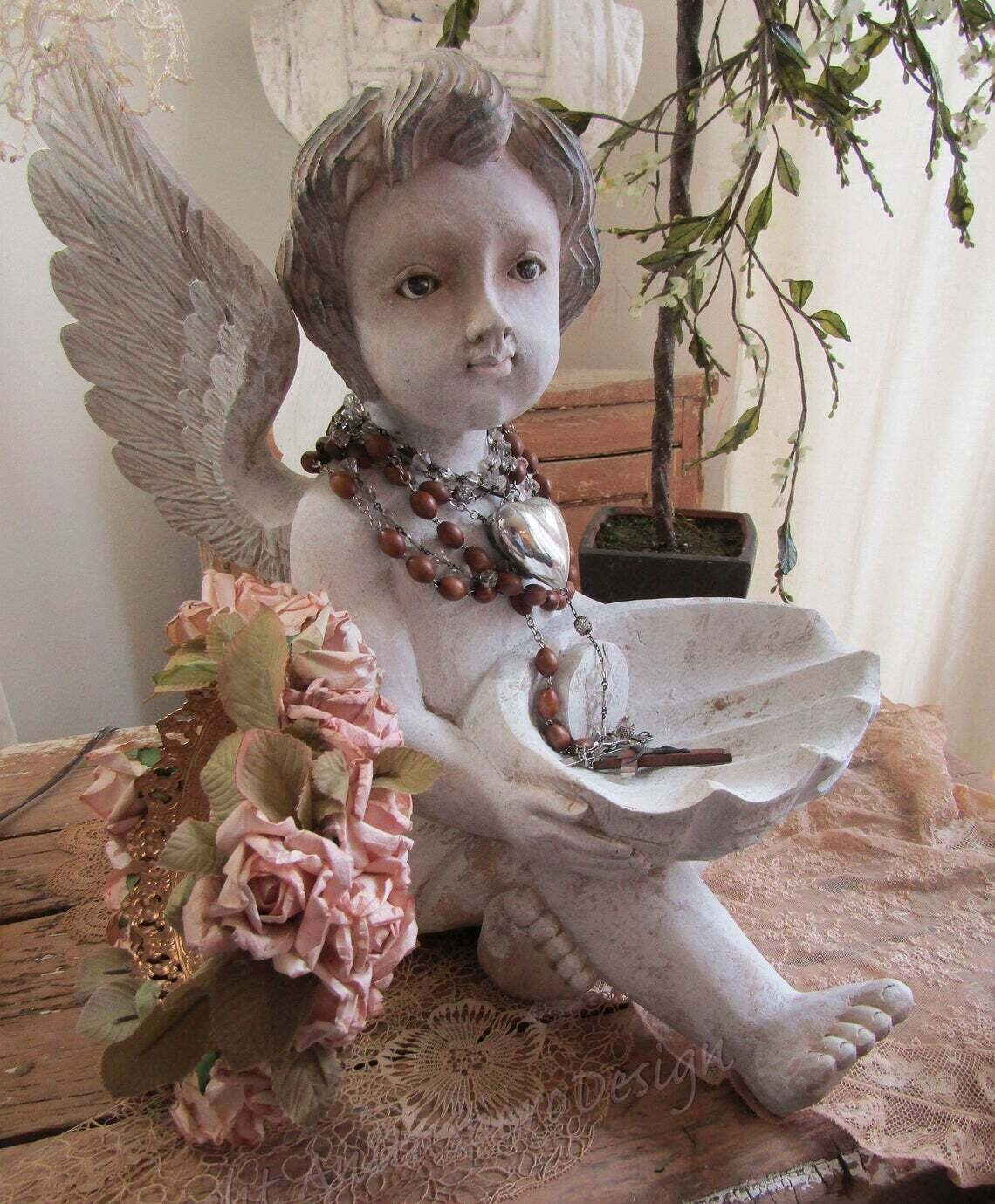 French Santos wood carved cherub with crown