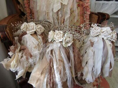 Set of wire gathering baskets embellished in roses and tattered fabric