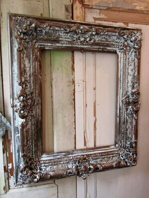 Large deep picture frame, ornate dark tones, antique wall decor