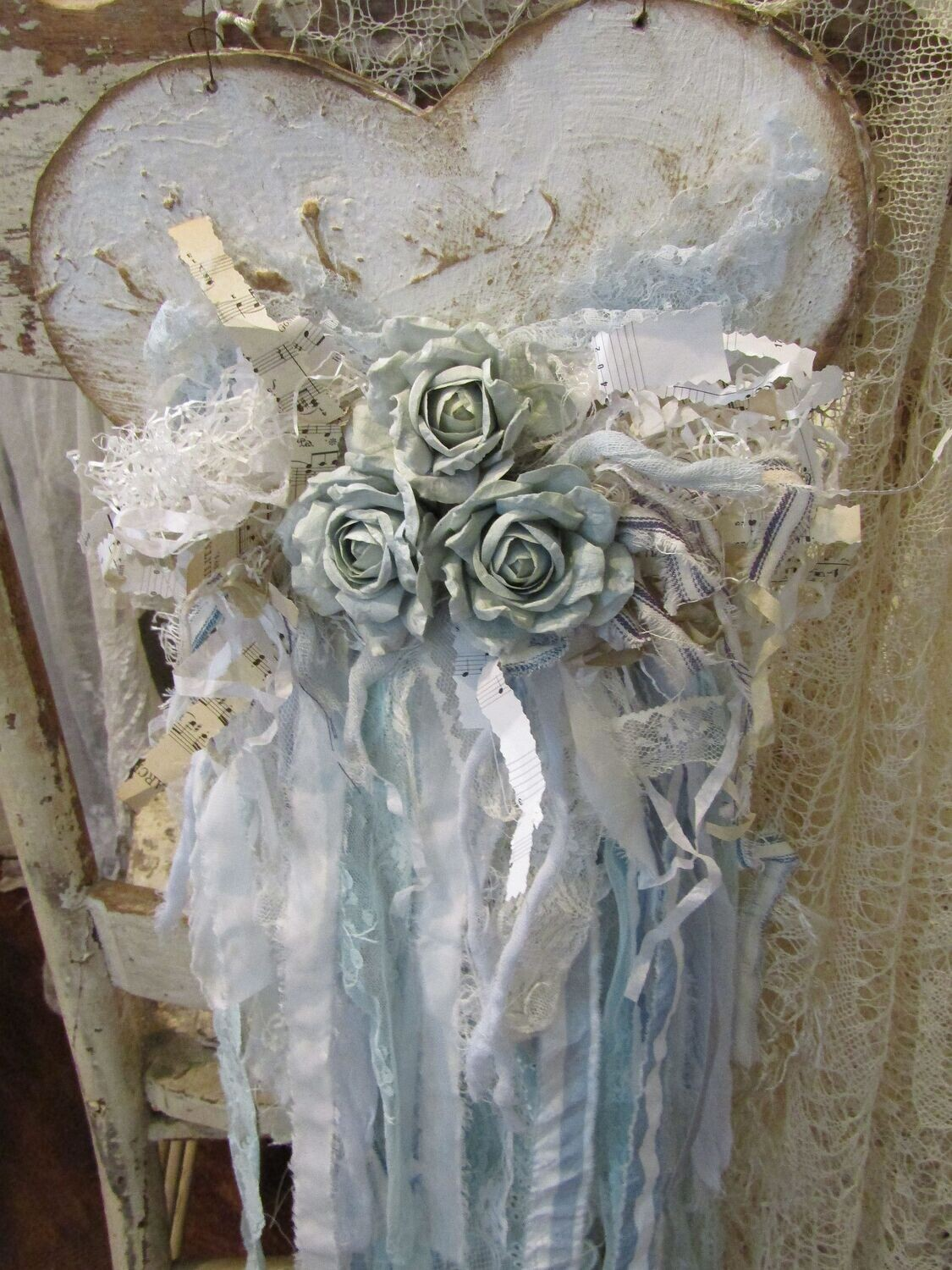 Shabby wall hanging handmade distressed heart filled with faded blue roses lace and shredded music sheets