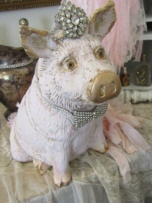 Pink cottage pig statue with crown, gold accents and rhinestone bowtie