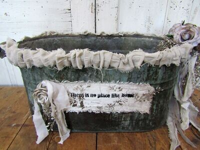 Large farmhouse boiler wash tub embellished in canvas and ecru colors