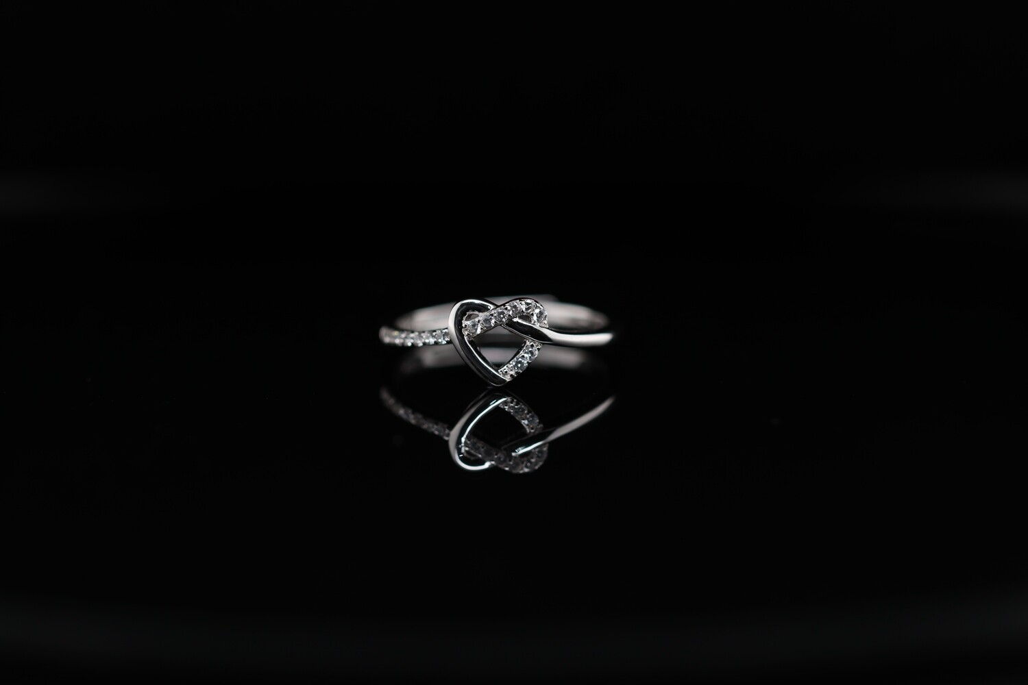 Solitaire Knotted Heart Sparkling Ring