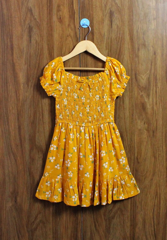 Yellow smoked dress(4 to 12 Yrs)