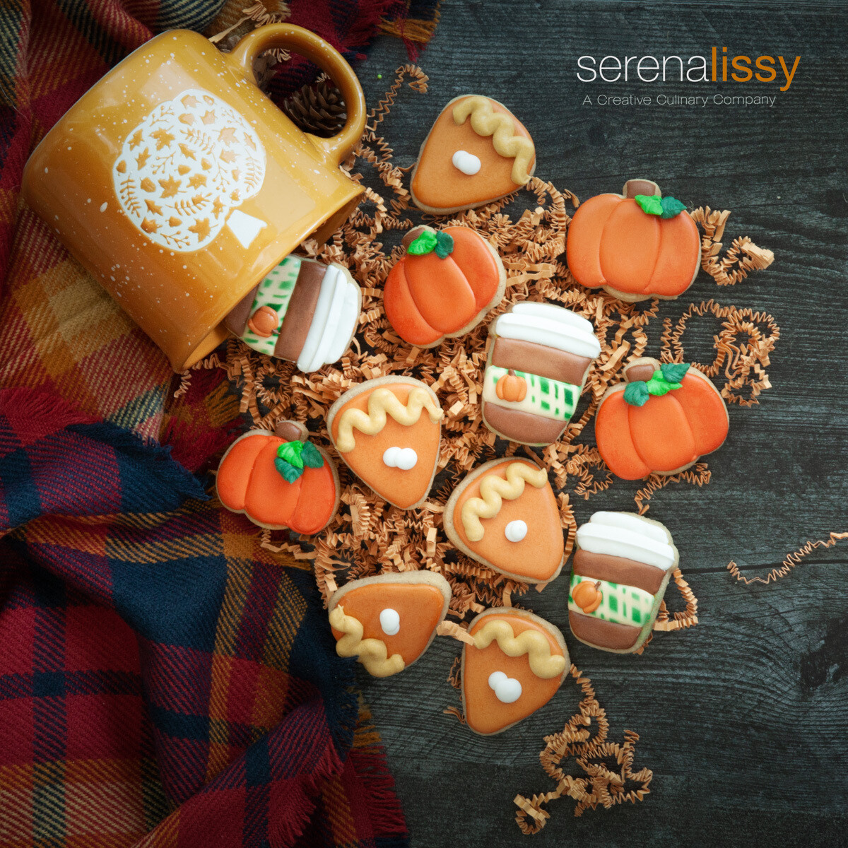 12 decorated mini sugar cookies with mug