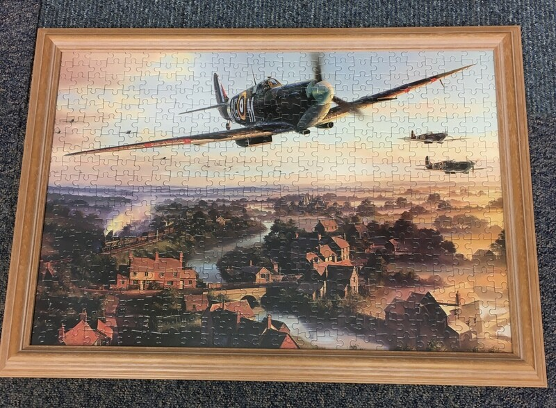 Spitfire in flight - Contains puzzle that can be reassembled and replaced back in frame