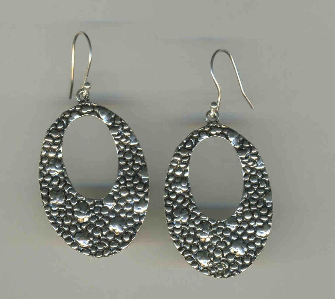 Carved silver earrings