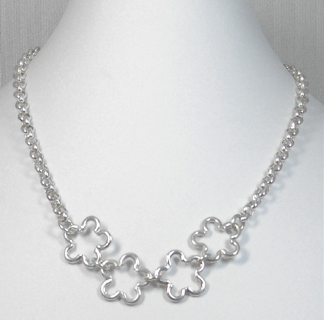 Silver chain with flower components