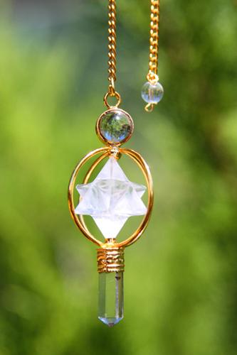 Spinning Merkaba Pendulum, with crystal Merkaba in the center imprinted with Einstein's energy wisdom.