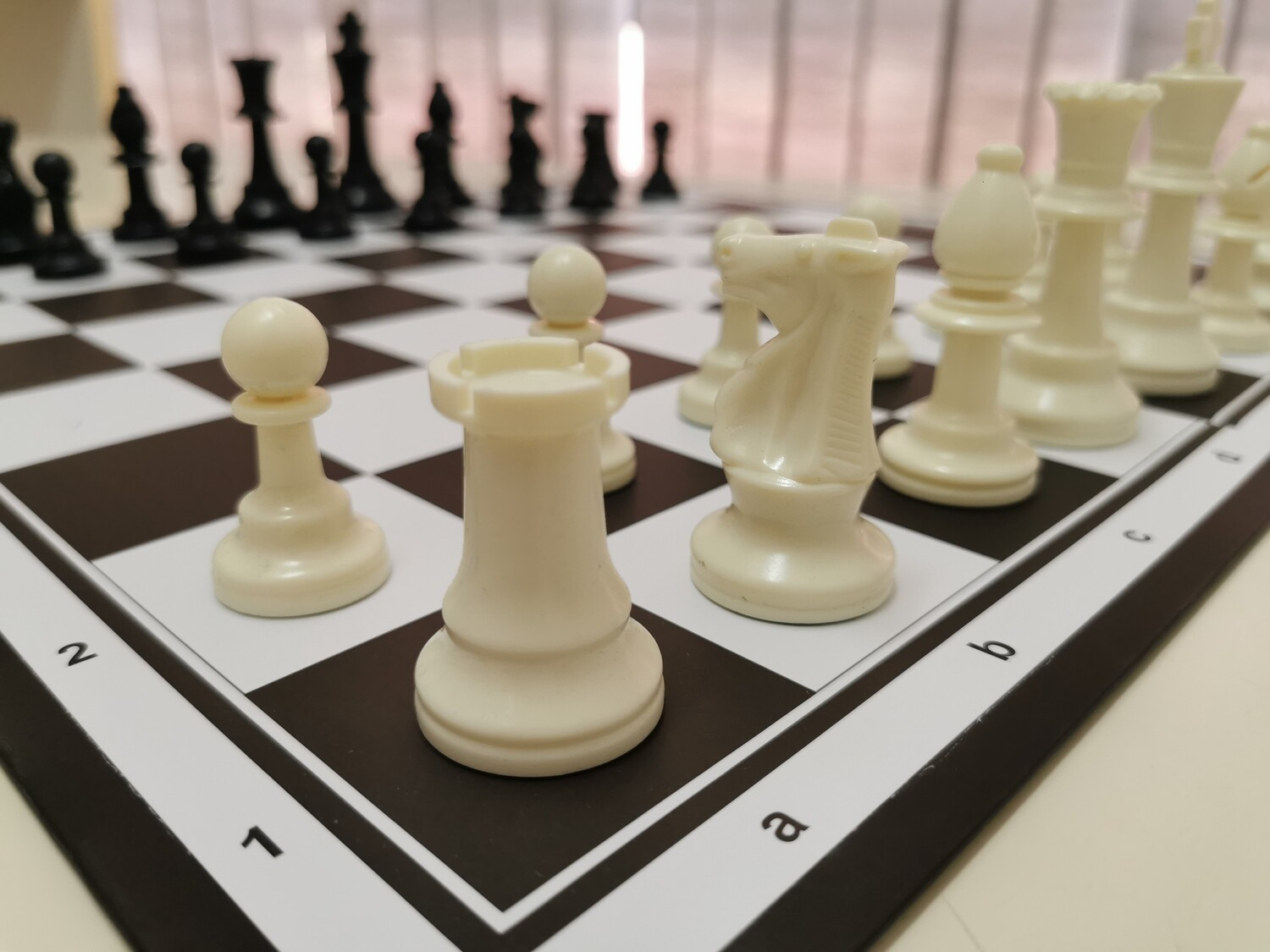 CHESS SET with foldable hard board, standard tournament size chess pieces with an extra Queen each and pouch for the pieces.