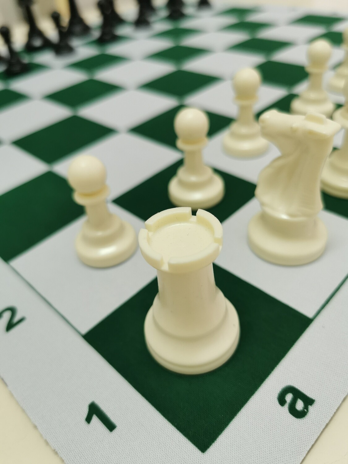 CHESS SET, rubber mat board and plastic pieces with extra Queen.