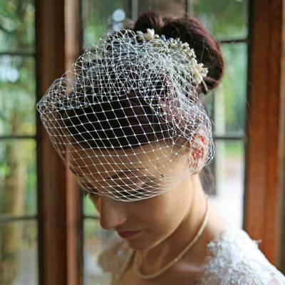 Cora with detachable veil