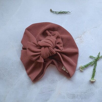 Barbett Cortrelli Knotted Bow Turban in Shimmer Spice