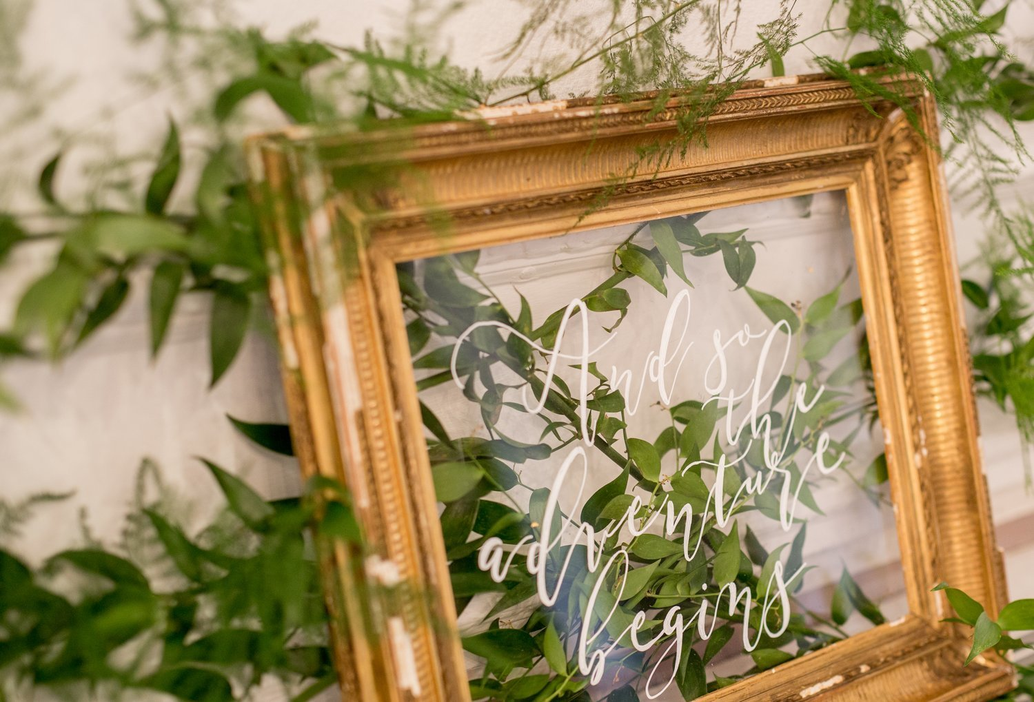 Antique frame 'And so the adventure Begins' sign