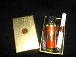 Gold foil gift box  lined with black satin holds one 1/4 oz.