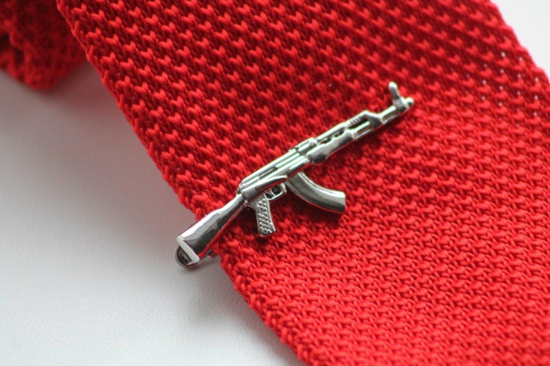 Gun lapel pin