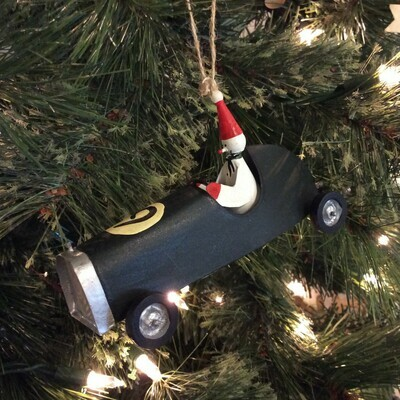 Hand-Painted Metal Snowman in Sports Car Ornament