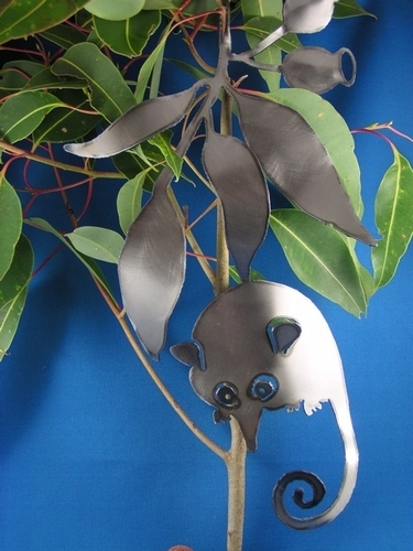 Honey possum with gumnuts and leaves Metal art