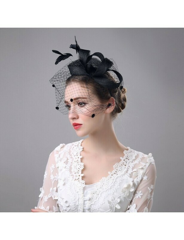 SCULPTURAL HAT WITH FEATHERS AND VEIL