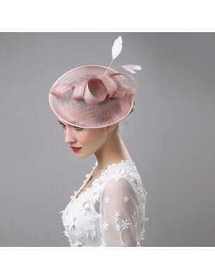 PINK HAT WITH SCULPTURAL ACCENT AND FEATHERS