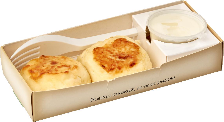 Два творожных сырника со сметаной