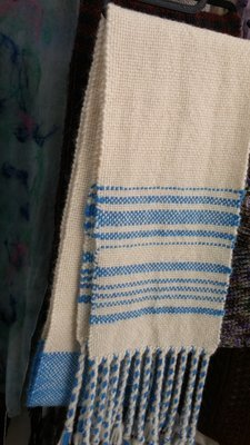 Scarf, White with blue stripes.