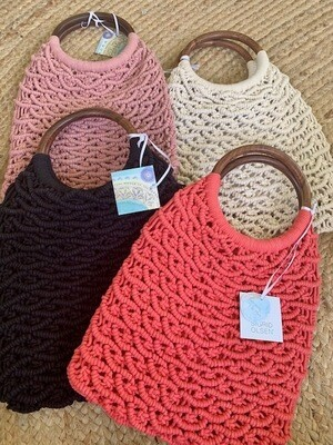 Cream Sigrid Olsen Basket Weave Purse. Marked down to $29.99 and three free gifts come with it.
