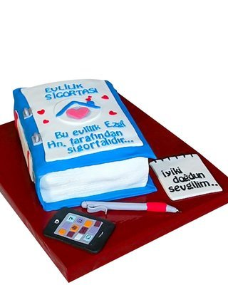 Buch Figur mit Smartphone Torte