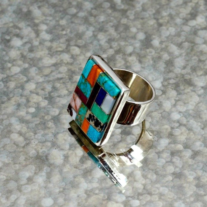 Image of the multi-stone inlay ring showing how the stones look great with the sterling silver backing